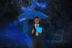 Composite image of portrait of businessman holding blue umbrella and file. Portrait of businessman holding blue umbrella and file against starry night sky Stock Photos