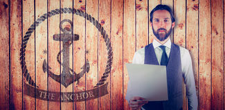 Composite image of portrait of businessman holding document. Portrait of businessman holding document against view of wooden planks Royalty Free Stock Photography