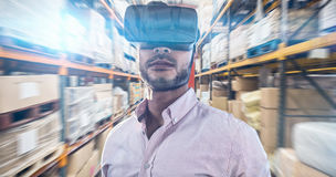 Composite image of portrait of businessman holding virtual glasses Stock Photos
