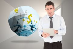 Composite image of portrait of a businessman with a tablet computer Stock Image