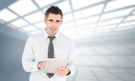Composite image of portrait of a businessman with a tablet computer Stock Photos