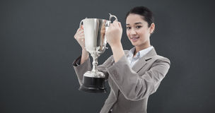 Composite image of portrait of a businesswoman holding a cup Stock Images