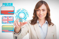 Composite image of portrait of businesswoman pointing her finger at camera Stock Images