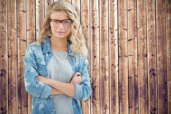 Composite image of portrait of businesswoman wearing eyeglasses with arms crossed Royalty Free Stock Photography