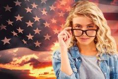 Composite image of portrait of businesswoman wearing eyeglasses posing Royalty Free Stock Image