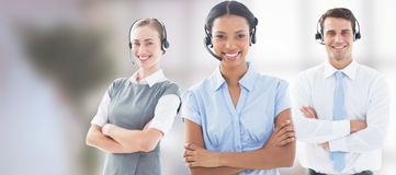 Composite image of portrait of call center executives standing with arms crossed Stock Photo
