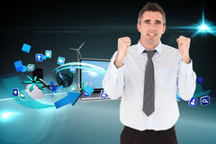 Composite image of portrait of a cheerful businessman with the fists up Royalty Free Stock Image