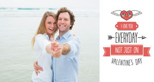 Composite image of portrait of cheerful couple dancing at beach Royalty Free Stock Image