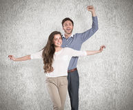 Composite image of portrait of cheerful young couple Royalty Free Stock Image