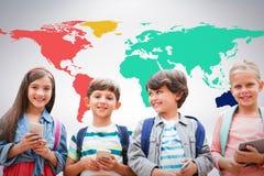 Composite image of portrait of children holding mobile phones Stock Photo
