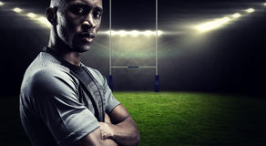 Composite image of portrait of confident athlete with arms crossed Royalty Free Stock Image