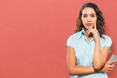 Composite image of portrait of confident businesswoman holding smart phone Stock Photos