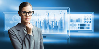 Composite image of portrait of confident businesswoman wearing eyeglasses. Portrait of confident businesswoman wearing eyeglasses against computer graphic image stock images