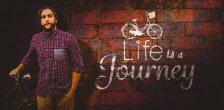 Composite image of portrait of confident hipster with bicycle Royalty Free Stock Photography