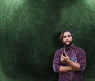 Composite image of portrait of confident hipster holding smoking pipe Stock Photography