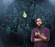 Composite image of portrait of confident hipster holding smoking pipe Royalty Free Stock Image