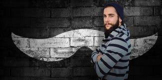 Composite image of portrait of confident hipster with hooded shirt. Portrait of confident hipster with hooded shirt against texture of bricks wall stock illustration