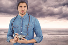 Composite image of portrait of confident  hipster using camera Stock Photo