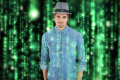 Composite image of portrait of confident hipster wearing hat Royalty Free Stock Images