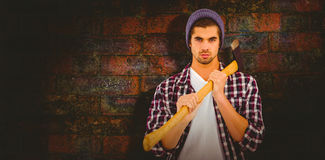 Composite image of portrait of confident man holding axe on shoulder Stock Photography