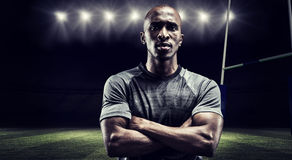 Composite image of portrait of confident rugby player with arms crossed Royalty Free Stock Images