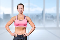 Composite image of portrait of confident slim woman Royalty Free Stock Photography