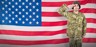 Composite image of portrait of confident soldier giving salute Stock Image