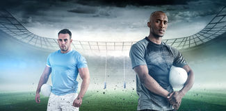 Composite image of portrait of confident sportsman with rugby ball Stock Photo