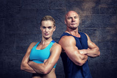 Composite image of portrait of confident strong man and woman royalty free stock photos