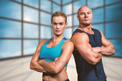 Composite image of portrait of confident strong man and woman Royalty Free Stock Images