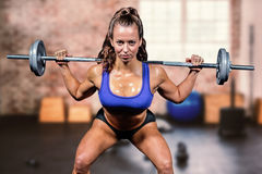 Composite image of portrait confident of woman lifting crossfit Stock Photos
