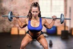 Composite image of portrait confident of woman lifting crossfit Stock Photos