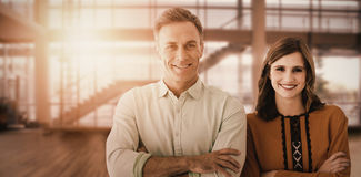 Composite image of portrait of couple with crossed arms royalty free stock image