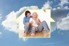 Composite image of portrait of a cute couple toasting Royalty Free Stock Photos