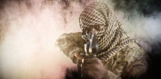 Composite image of portrait of face covered soldier aiming with rifle Royalty Free Stock Photo