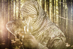 Composite image of portrait of face covered soldier aiming with rifle Stock Photos