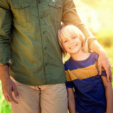 Composite image of portrait of a father with his son stock photos
