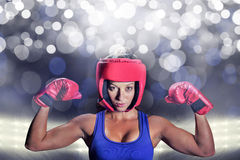 Composite image of portrait of female fighter with gloves and headgear Stock Images
