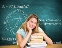 Composite image of portrait of female student in library Stock Photo