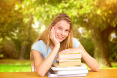 Composite image of portrait of female student in library Royalty Free Stock Photo