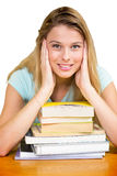 Composite image of portrait of female student in library. Portrait of female student in library against white background with vignette Stock Images