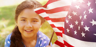 Composite image of portrait of girl with american flag. Portrait of girl with American flag against focus on usa flag Royalty Free Stock Photos