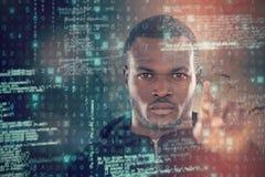 Composite image of portrait of hacker using digital screen Stock Images