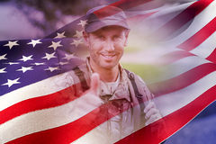 Composite image of portrait of happy army man with thumbs up Stock Photos