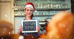 Composite image of portrait of happy barista holding christmas at cafe Royalty Free Stock Photos