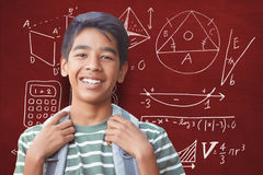 Composite image of portrait of happy boy with backpack Stock Image
