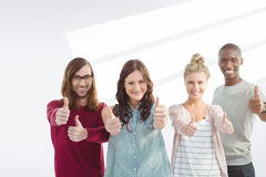 Composite image of portrait of happy business team with thumbs up Royalty Free Stock Image