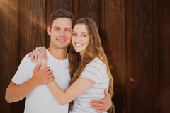 Composite image of portrait of happy couple embracing Royalty Free Stock Photo