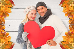 Composite image of portrait of happy couple holding heart Stock Image
