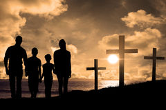 Composite image of portrait of happy family walking over white background. Portrait of happy family walking over white background against cross religion symbol Royalty Free Stock Images